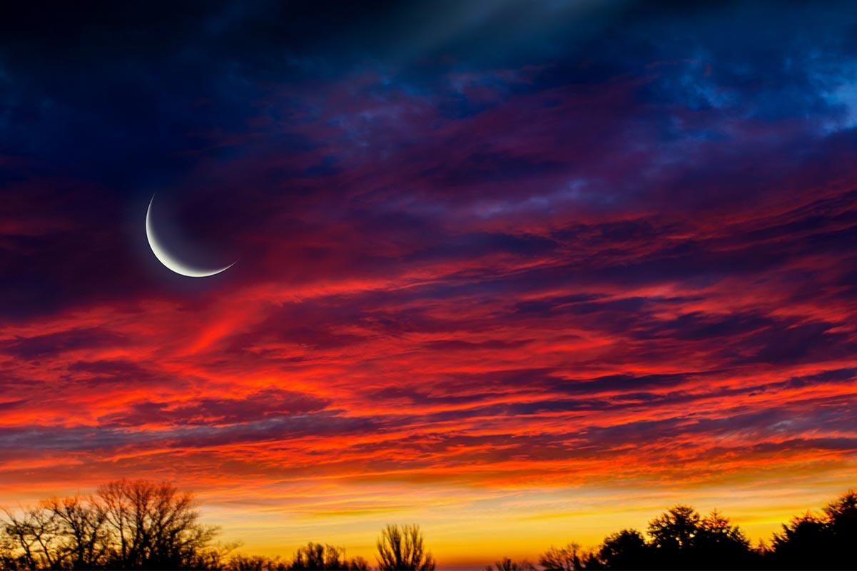 Måne-i-solnedgang